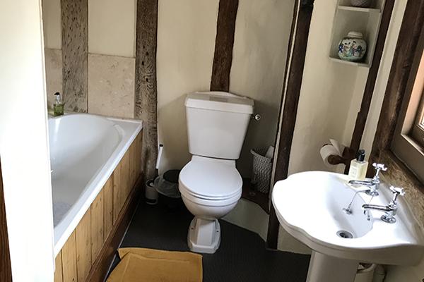 Toilet adjoining double bedroom
